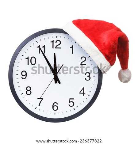 Christmas time concept. Santa hat hanging on a clock isolated on a white background - stock photo
