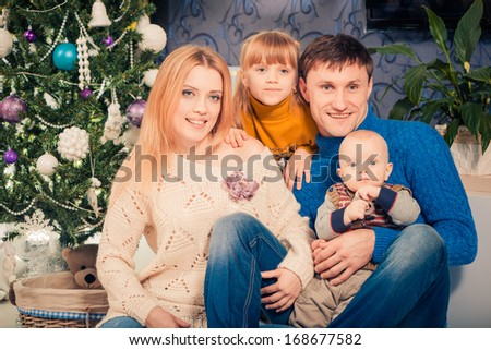 Christmas time indoor family portrait  - stock photo
