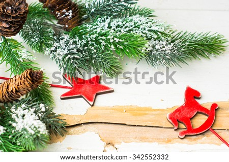 Christmas time interior decorations on the rustic background with candle lamp and fir tree