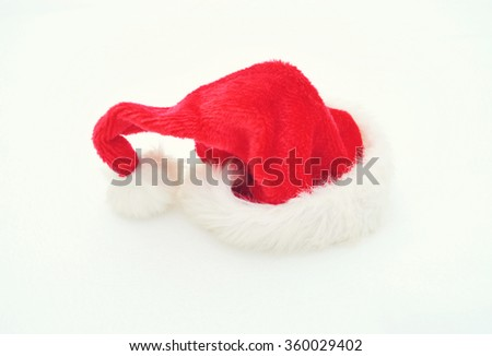 Christmas time - Santa Claus hat isolated on white - stock photo