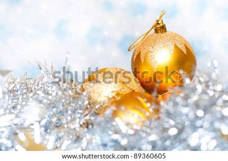 Christmas tinsel  decoration with balls and colorful  background - stock photo