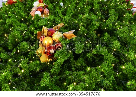 christmas tinsel ornament decorating on twig of christmas tree (holiday concept) - stock photo