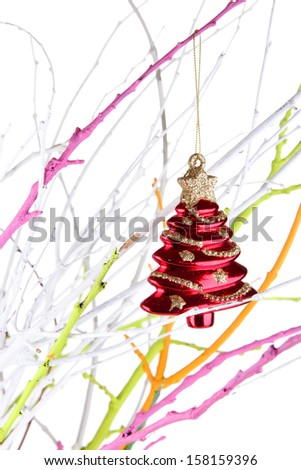 Christmas toy hanging on branch isolated on white - stock photo