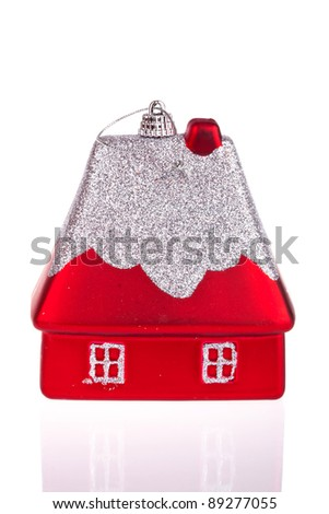 Christmas toy in the form of a small house isolated on white - stock photo