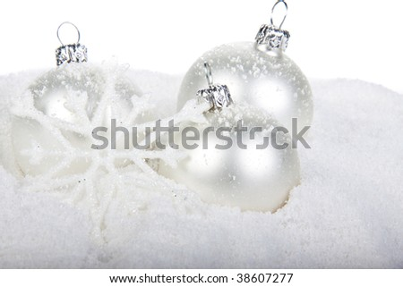 Christmas toy on a snow over white background