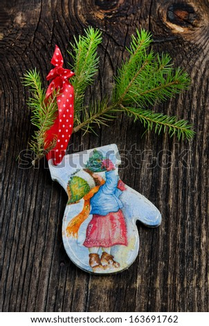 Christmas toy  on the old wooden background - stock photo