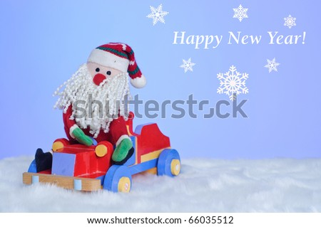 Christmas Toy Santa Claus on a wooden car - stock photo