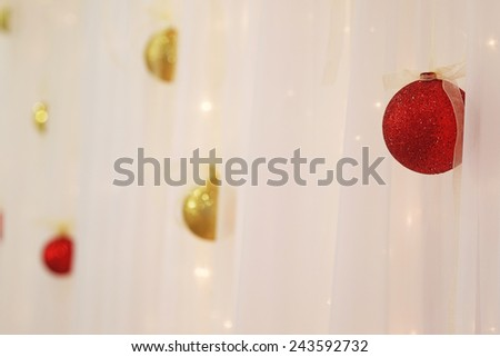 Christmas toys on the curtains - stock photo