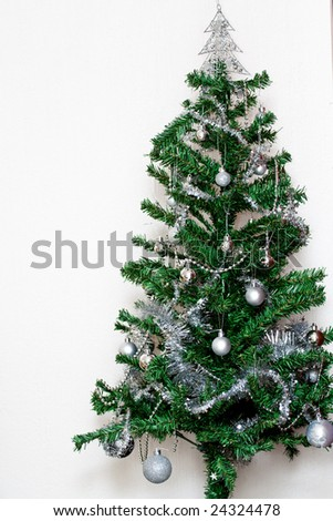 Christmas tree against white background - stock photo