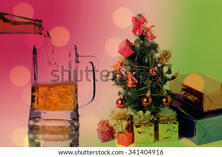Christmas tree and beer drink celebration with bokeh lights - stock photo