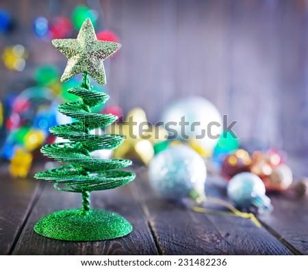 christmas tree and christmas decoration on atable - stock photo