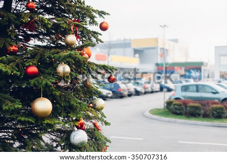 Christmas tree and Christmas decorations in the parking lot of the shopping center - stock photo