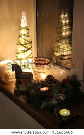 Christmas tree and decorations with burning candles