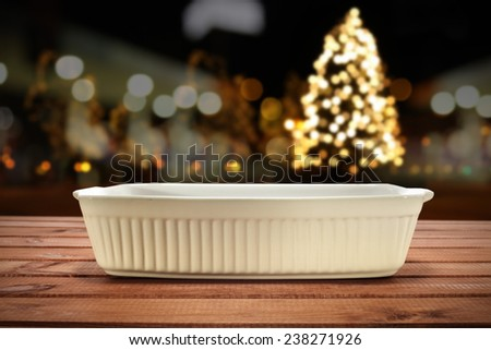 christmas tree and empty plate on kitchen table  - stock photo