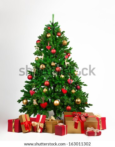 Christmas tree and many present boxes - stock photo