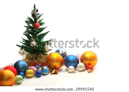 Christmas tree and ornaments, isolated on white - stock photo