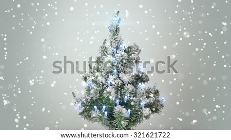 christmas tree and turbulent snowfall holiday background - stock photo