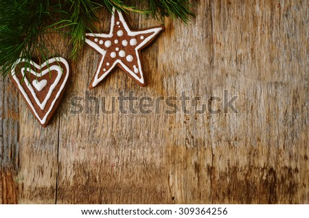 Christmas tree background with Christmas tree and gingerbread shaped cookies. the toning. selective focus - stock photo
