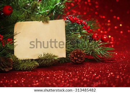 Christmas tree banches with blank note - stock photo