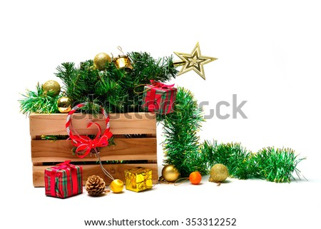 Christmas tree bauble and ornament in a box on white background