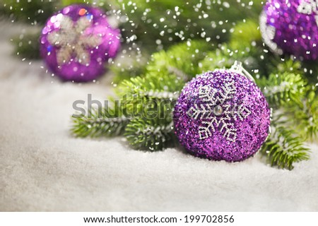 Christmas tree bauble with snow falling - stock photo