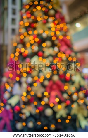 Christmas tree blur background. abstract christmas background with defocused lights