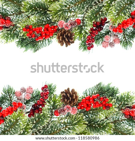christmas tree branch decoration with red berries isolated on white background. - stock photo