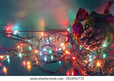 Christmas-tree branch pine cone and garlands - stock photo