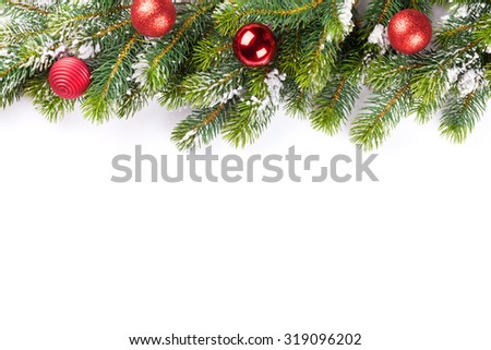 Christmas tree branch with baubles decor. Isolated on white background
