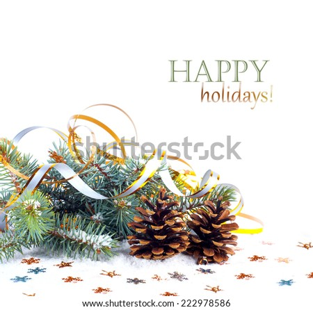 Christmas tree branch with gold serpentine and star on white background isolated  - stock photo