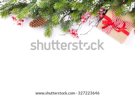 Christmas tree branch with snow and gift box. Isolated on white background with copy space - stock photo