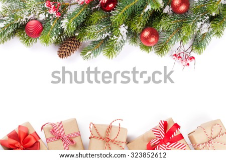 Christmas tree branch with snow and gift boxes. Isolated on white background with copy space - stock photo