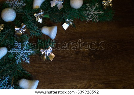 Christmas-tree branch with white snowflakes and bells