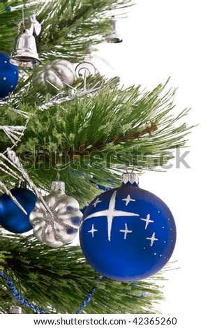 Christmas tree branches,  blue Christmas balls and decorations isolated on white background
