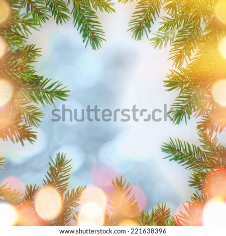 Christmas tree branches border over white - stock photo