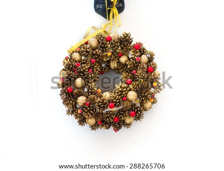 Christmas tree branches in a circle with Christmas toys. - stock photo