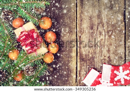 Christmas tree branches on old boards. Christmas background. Christmas Socks. Christmas decorations. New Year background. Xmax background. Toned image. Falling Snow. - stock photo