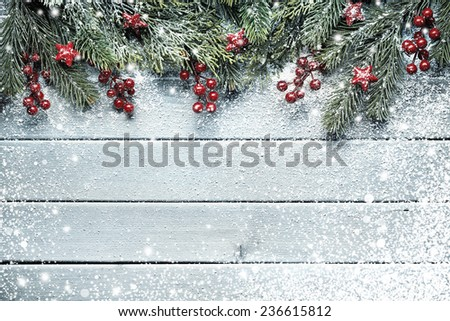 Christmas tree branches on wood background - stock photo