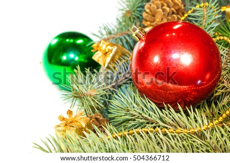 Christmas tree branches with cones, gifts and toys on a white ba