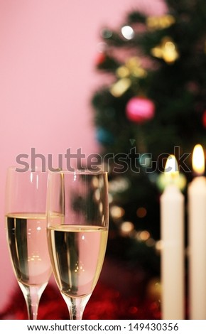 Christmas tree, candles and two glasses of champagne - stock photo