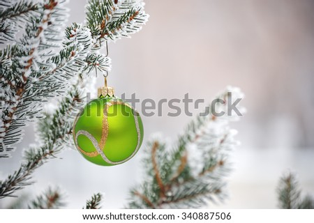 Christmas Tree, Christmas toy on a branch of spruce sheltered sn - stock photo