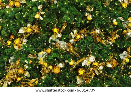 christmas tree closeup with gold and silver ornament - stock photo