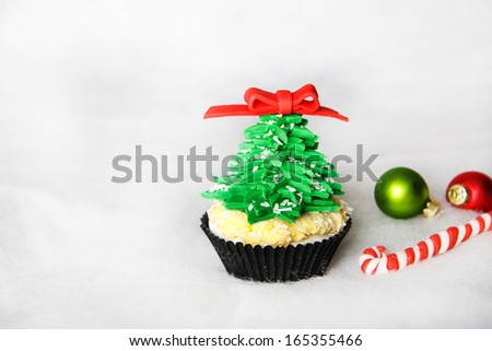 Christmas tree cupcake with white fondant and creme cheese frosting - stock photo