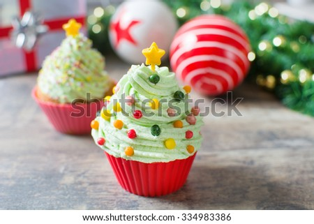 Christmas tree cupcakes with Christmas decoration - stock photo