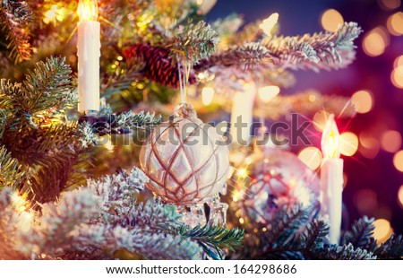 Christmas Tree Decorated with Baubles, Garlands and Candles. Retro Style. Vintage - stock photo