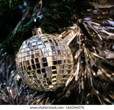 Christmas tree decorated with mirror disco ball.  - stock photo