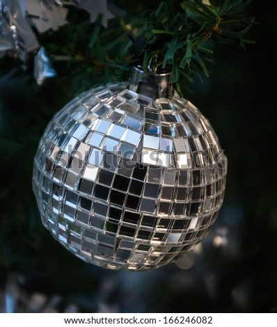 Christmas tree decorated with mirror disco ball.