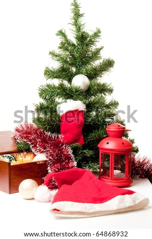 Christmas-tree decoration and gifts on a white background under a fur-tree for a card