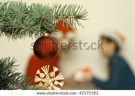 Christmas tree decoration Bauble with Santa Claus and boy background