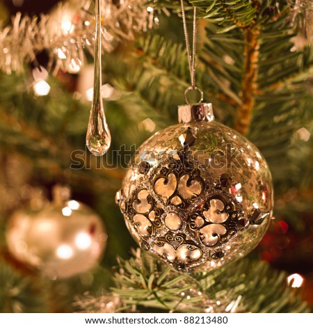 Christmas tree decoration in silver and glass - square image with shallow dof - stock photo